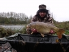 Adrian Knowless 19lbs 2oz common carp from turf pool using code red 18mm.. code red boilies  on the deck