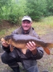 12lbs 2oz carp common from private quarry nr doncaster. got this carp on sweetcorrn , my darkest  carp I have ever cought,...