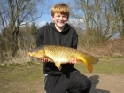 Dean Jones 12lbs 7oz Common Carp from turf pool using dynamite baits pinapple and tigernut crunch.