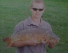 Aaron Whiteside 13lbs 8oz Carp from Upham Farm Ponds. Caught on a legered 21mm Marine Halibut Pellet.
