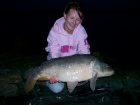 Kirsty Barnett 17lbs 9oz carp from Bain Valley Fisheries using Spicy tuna and sweet chilli.