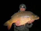 30lbs 2oz Mirror Carp from Sweet Chestnut Lake. Groundbait feeder, to open water, with maize as hookbait.