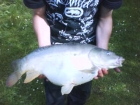 Ashley Orrow 10lbs 4oz Mirror Carp from Cudmore Fisheries. dog biscuit