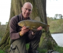 5lbs 1oz Tench from Secret Lake using Enterprise Tackle.. Caught from a pre-baited swim at 40 yards range at the edge of emerging lily pads. Using a 12ft Greys X-Flight Barbel rod, Shimano Baitrunner