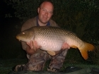 27lbs 8oz Common Carp from Les Burons Carp Fishing using Nutrabaits Trigga.. Caught fishing to right side of small island in 3 feet of water. Using Century NG Rods, Shimano 6000GTE reels, 15lbs