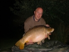 27lbs 8oz Mirror Carp from Les Burons Carp Fishing using Mainline Fusion.. Caught fishing to far bank reed bed. (in front of house) Using Century NG Rods, Shimano 6000GTE reels, 15lbs Shimano Catana